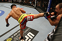 SAN JOSE, CA - NOVEMBER 19: (L-R) Cung Le back kicks Wanderlei Silva during an UFC Middleweight bout at the HP Pavillion on November 19, 2011 in San Jose, California.  (Photo by Josh Hedges/Zuffa LLC/Zuffa LLC via Getty Images)