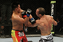 SAN JOSE, CA - NOVEMBER 19: (R-L) Wanderlei Silva punches Cung Le during an UFC Middleweight bout at the HP Pavillion on November 19, 2011 in San Jose, California.  (Photo by Josh Hedges/Zuffa LLC/Zuffa LLC via Getty Images)