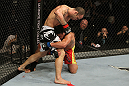 SAN JOSE, CA - NOVEMBER 19: (L-R) Wanderlei Silva punches Cung Le wrapped arund his leg during an UFC Middleweight bout at the HP Pavillion on November 19, 2011 in San Jose, California.  (Photo by Josh Hedges/Zuffa LLC/Zuffa LLC via Getty Images)