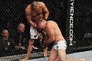 SAN JOSE, CA - NOVEMBER 19: (R-L) Mauricio Rua grabs hold of Dan Henderson's leg while taking a punch during an UFC Light Heavyweight bout at the HP Pavillion on November 19, 2011 in San Jose, California.  (Photo by Josh Hedges/Zuffa LLC/Zuffa LLC via Getty Images)