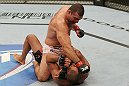 SAN JOSE, CA - NOVEMBER 19: Mauricio Rua (top) punches Dan Henderson (bottom) during an UFC Light Heavyweight bout at the HP Pavillion on November 19, 2011 in San Jose, California.  (Photo by Josh Hedges/Zuffa LLC/Zuffa LLC via Getty Images)