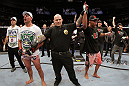 SAN JOSE, CA - NOVEMBER 19: (R-L) Dan Henderson celebrates defeating Mauricio Rua during an UFC Light Heavyweight bout at the HP Pavillion on November 19, 2011 in San Jose, California.  (Photo by Josh Hedges/Zuffa LLC/Zuffa LLC via Getty Images)