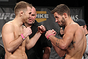 LAS VEGAS, NV - DECEMBER 02:  (L-R) Opponents Bryan Caraway and Dustin Neace face off after weighing in at the official weigh-in for The Ultimate Fighter 14 Finale at The Palms Casino Resort on December 2, 2011 in Las Vegas, Nevada.  (Photo by Josh Hedges/Zuffa LLC/Zuffa LLC via Getty Images)