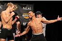 LAS VEGAS, NV - DECEMBER 02:  (L-R) Bantamweight opponents TJ Dillashaw and John Dodson face off after weighing in at the official weigh-in for The Ultimate Fighter 14 Finale at The Palms Casino Resort on December 2, 2011 in Las Vegas, Nevada.  (Photo by Josh Hedges/Zuffa LLC/Zuffa LLC via Getty Images)