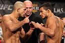 LAS VEGAS, NV - DECEMBER 02:  (L-R) Featherweight opponents Diego Brandao and Dennis Bermudez face off after weighing in at the official weigh-in for The Ultimate Fighter 14 Finale at The Palms Casino Resort on December 2, 2011 in Las Vegas, Nevada.  (Photo by Josh Hedges/Zuffa LLC/Zuffa LLC via Getty Images)
