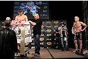 LAS VEGAS, NV - DECEMBER 02:  Michael Bisping (L) weighs in as his opponent Jason Miller (R) looks on at the official weigh-in for The Ultimate Fighter 14 Finale at The Palms Casino Resort on December 2, 2011 in Las Vegas, Nevada.  (Photo by Josh Hedges/Zuffa LLC/Zuffa LLC via Getty Images)