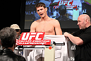 LAS VEGAS, NV - DECEMBER 02:  Michael Bisping pleads his case to a commission official after missing weight at the official weigh-in for The Ultimate Fighter 14 Finale at The Palms Casino Resort on December 2, 2011 in Las Vegas, Nevada.  (Photo by Josh Hedges/Zuffa LLC/Zuffa LLC via Getty Images)