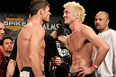 "LAS VEGAS, NV - DECEMBER 02:  (L-R) Middleweight opponents Michael Bisping and Jason ""Mayhem"" Miller face off after weighing in at the official weigh-in for The Ultimate Fighter 14 Finale at The Palms Casino Resort on December 2, 2011 in Las Vegas, Nevada.  (Photo by Josh Hedges/Zuffa LLC/Zuffa LLC via Getty Images)"