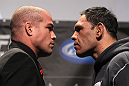 "TORONTO, ON - DECEMBER 08:  (L-R) Light Heavyweight opponents Tito Ortiz and Antonio Rogerio ""Minotoro"" Nogueira face off at the final UFC 140 pre-fight press conference at Bell Tiff Lightbox Cinema1 on December 8, 2011 in Toronto, Canada.  (Photo by Josh Hedges/Zuffa LLC/Zuffa LLC via Getty Images)"