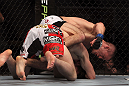 TORONTO, ON - DECEMBER 10:  (R-L) John Cholish punches Mitch Clarke during the UFC 140 event at Air Canada Centre on December 10, 2011 in Toronto, Ontario, Canada.  (Photo by Josh Hedges/Zuffa LLC/Zuffa LLC via Getty Images)