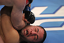 TORONTO, ON - DECEMBER 10:  John Makdessi absorbs an elbow strike from Dennis Hallman during the UFC 140 event at Air Canada Centre on December 10, 2011 in Toronto, Ontario, Canada.  (Photo by Nick Laham/Zuffa LLC/Zuffa LLC via Getty Images)