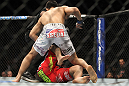 "TORONTO, ON - DECEMBER 10:  ""The Korean Zombie"" Chan Sung Jung (white shorts) defeats Mark Hominick by knockout during the UFC 140 event at Air Canada Centre on December 10, 2011 in Toronto, Ontario, Canada.  (Photo by Josh Hedges/Zuffa LLC/Zuffa LLC via Getty Images)"