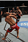 "TORONTO, ON - DECEMBER 10:  (R-L) Jon ""Bones"" Jones kicks Lyoto Machida during the UFC 140 event at Air Canada Centre on December 10, 2011 in Toronto, Ontario, Canada.  (Photo by Nick Laham/Zuffa LLC/Zuffa LLC via Getty Images)"