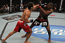 "TORONTO, ON - DECEMBER 10:  (L-R) Lyoto Machida punches Jon ""Bones"" Jones during the UFC 140 event at Air Canada Centre on December 10, 2011 in Toronto, Ontario, Canada.  (Photo by Nick Laham/Zuffa LLC/Zuffa LLC via Getty Images)"