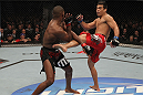 "TORONTO, ON - DECEMBER 10:  (R-L) Lyoto Machida kicks Jon ""Bones"" Jones during the UFC 140 event at Air Canada Centre on December 10, 2011 in Toronto, Ontario, Canada.  (Photo by Nick Laham/Zuffa LLC/Zuffa LLC via Getty Images)"