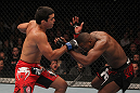 TORONTO, ON - DECEMBER 10:  (L-R) Lyoto Machida punches Jon