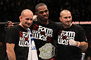 TORONTO, ON - DECEMBER 10:  UFC Light Heavyweight Champion Jon &quot;Bones&quot; Jones poses for a photo with his trainers Greg Jackson (L) and Mike Winklejohn (R) after defeating Lyoto Machida during the UFC 140 event at Air Canada Centre on December 10, 2011 in Toronto, Ontario, Canada.  (Photo by Nick Laham/Zuffa LLC/Zuffa LLC via Getty Images)