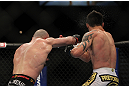 LAS VEGAS, NV - DECEMBER 30:  Manny Gamburyan (left) punches Diego Nunes (right) during the UFC 141 event at the MGM Grand Garden Arena on December 30, 2011 in Las Vegas, Nevada.  (Photo by Josh Hedges/Zuffa LLC/Zuffa LLC via Getty Images) *** Local Caption *** Manny Gamburyan; Diego Nunes
