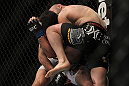 LAS VEGAS, NV - DECEMBER 30:  Manny Gamburyan (black shorts) knees Diego Nunes during the UFC 141 event at the MGM Grand Garden Arena on December 30, 2011 in Las Vegas, Nevada.  (Photo by Josh Hedges/Zuffa LLC/Zuffa LLC via Getty Images) *** Local Caption *** Manny Gamburyan; Diego Nunes