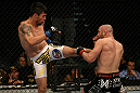 LAS VEGAS, NV - DECEMBER 30:  Diego Nunes (left) kicks Manny Gamburyan (right) during the UFC 141 event at the MGM Grand Garden Arena on December 30, 2011 in Las Vegas, Nevada.  (Photo by Donald Miralle/Zuffa LLC/Zuffa LLC via Getty Images) *** Local Caption *** Diego Nunes; Manny Gamburyan