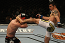 LAS VEGAS, NV - DECEMBER 30:  Diego Nunes (right) throws a headkick at Manny Gamburyan (left) during the UFC 141 event at the MGM Grand Garden Arena on December 30, 2011 in Las Vegas, Nevada.  (Photo by Donald Miralle/Zuffa LLC/Zuffa LLC via Getty Images) *** Local Caption *** Diego Nunes; Manny Gamburyan