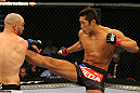 LAS VEGAS, NV - DECEMBER 30:  Dong Hyun Kim (right) throws a kick at Sean Pierson (left) during the UFC 141 event at the MGM Grand Garden Arena on December 30, 2011 in Las Vegas, Nevada.  (Photo by Donald Miralle/Zuffa LLC/Zuffa LLC via Getty Images) *** Local Caption *** Dong Hyun Kim; Sean Pierson
