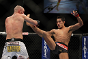 LAS VEGAS, NV - DECEMBER 30:  Dong Hyun Kim (black shorts) throws a kick at Sean Pierson (white shorts) during the UFC 141 event at the MGM Grand Garden Arena on December 30, 2011 in Las Vegas, Nevada.  (Photo by Josh Hedges/Zuffa LLC/Zuffa LLC via Getty Images) *** Local Caption *** Dong Hyun Kim; Sean Pierson