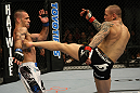 LAS VEGAS, NV - DECEMBER 30:  Ross Pearson (right) kicks Junior Assuncao (left) during the UFC 141 event at the MGM Grand Garden Arena on December 30, 2011 in Las Vegas, Nevada.  (Photo by Donald Miralle/Zuffa LLC/Zuffa LLC via Getty Images) *** Local Caption *** Ross Pearson; Junior Assuncao