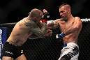 LAS VEGAS, NV - DECEMBER 30:  Junior Assuncao (right) punches Ross Pearson during the UFC 141 event at the MGM Grand Garden Arena on December 30, 2011 in Las Vegas, Nevada.  (Photo by Josh Hedges/Zuffa LLC/Zuffa LLC via Getty Images) *** Local Caption *** Junior Assuncao; Ross Pearson