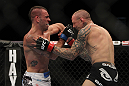 LAS VEGAS, NV - DECEMBER 30:  Junior Assuncao (left) hits Ross Pearson (right) during the UFC 141 event at the MGM Grand Garden Arena on December 30, 2011 in Las Vegas, Nevada.  (Photo by Josh Hedges/Zuffa LLC/Zuffa LLC via Getty Images) *** Local Caption *** Junior Assuncao; Ross Pearson