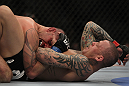 LAS VEGAS, NV - DECEMBER 30:  Ross Pearson (right) throws elbows at Junior Assuncao (left) during the UFC 141 event at the MGM Grand Garden Arena on December 30, 2011 in Las Vegas, Nevada.  (Photo by Josh Hedges/Zuffa LLC/Zuffa LLC via Getty Images) *** Local Caption *** Ross Pearson; Junior Assuncao