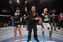 LAS VEGAS, NV - DECEMBER 30:  Ross Pearson (left) is declared the winner over his opponent Junior Assuncao (right) during the UFC 141 event at the MGM Grand Garden Arena on December 30, 2011 in Las Vegas, Nevada.  (Photo by Donald Miralle/Zuffa LLC/Zuffa LLC via Getty Images) *** Local Caption *** Ross Pearson; Junior Assuncao