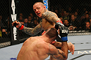 LAS VEGAS, NV - DECEMBER 30:  Ross Pearson (top) kicks Junior Assuncao during the UFC 141 event at the MGM Grand Garden Arena on December 30, 2011 in Las Vegas, Nevada.  (Photo by Donald Miralle/Zuffa LLC/Zuffa LLC via Getty Images) *** Local Caption *** Ross Pearson; Junior Assuncao