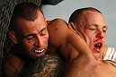 LAS VEGAS, NV - DECEMBER 30:  Junior Assuncao (left) and Ross Pearson (right) grapple for position during the UFC 141 event at the MGM Grand Garden Arena on December 30, 2011 in Las Vegas, Nevada.  (Photo by Donald Miralle/Zuffa LLC/Zuffa LLC via Getty Images) *** Local Caption *** Junior Assuncao; Ross Pearson