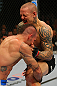 LAS VEGAS, NV - DECEMBER 30:  Ross Pearson (right) blocks a takedown attempt from Junior Assuncao during the UFC 141 event at the MGM Grand Garden Arena on December 30, 2011 in Las Vegas, Nevada.  (Photo by Donald Miralle/Zuffa LLC/Zuffa LLC via Getty Images) *** Local Caption *** Ross Pearson; Junior Assuncao