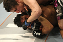 LAS VEGAS, NV - DECEMBER 30:  Jimy Hettes (top) punches Nam Phan during the UFC 141 event at the MGM Grand Garden Arena on December 30, 2011 in Las Vegas, Nevada.  (Photo by Donald Miralle/Zuffa LLC/Zuffa LLC via Getty Images) *** Local Caption *** Jimy Hettes; Nam Phan