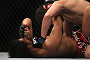 LAS VEGAS, NV - DECEMBER 30:  Jimy Hettes (top) punches Nam Phan during the UFC 141 event at the MGM Grand Garden Arena on December 30, 2011 in Las Vegas, Nevada.  (Photo by Josh Hedges/Zuffa LLC/Zuffa LLC via Getty Images) *** Local Caption *** Jimy Hettes; Nam Phan