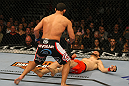 LAS VEGAS, NV - DECEMBER 30:  Johny Hendricks (black shorts) follows Jon Fitch after a knockout blow during the UFC 141 event at the MGM Grand Garden Arena on December 30, 2011 in Las Vegas, Nevada.  (Photo by Donald Miralle/Zuffa LLC/Zuffa LLC via Getty Images) *** Local Caption *** Johny Hendricks; Jon Fitch