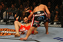 LAS VEGAS, NV - DECEMBER 30:  Johny Hendricks (black shorts) punches Jon Fitch during the UFC 141 event at the MGM Grand Garden Arena on December 30, 2011 in Las Vegas, Nevada.  (Photo by Donald Miralle/Zuffa LLC/Zuffa LLC via Getty Images) *** Local Caption *** Johny Hendricks; Jon Fitch