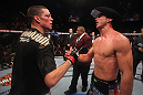 LAS VEGAS, NV - DECEMBER 30:  Nate Diaz (left) and Donald Cerrone (right) shake hands after their fight during the UFC 141 event at the MGM Grand Garden Arena on December 30, 2011 in Las Vegas, Nevada.  (Photo by Donald Miralle/Zuffa LLC/Zuffa LLC via Getty Images) *** Local Caption *** Nate Diaz; Donald Cerrone