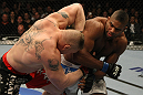 LAS VEGAS, NV - DECEMBER 30:  Alistair Overeem (right) punches Brock Lesnar (left) during the UFC 141 event at the MGM Grand Garden Arena on December 30, 2011 in Las Vegas, Nevada.  (Photo by Donald Miralle/Zuffa LLC/Zuffa LLC via Getty Images) *** Local Caption *** Alistair Overeem; Brock Lesnar