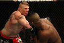 LAS VEGAS, NV - DECEMBER 30:  Brock Lesnar (left) throws a punch at Alistair Overeem during the UFC 141 event at the MGM Grand Garden Arena on December 30, 2011 in Las Vegas, Nevada.  (Photo by Donald Miralle/Zuffa LLC/Zuffa LLC via Getty Images) *** Local Caption *** Brock Lesnar; Alistair Overeem