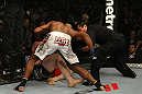 LAS VEGAS, NV - DECEMBER 30:  Alistair Overeem (white shorts) punches Brock Lesnar during the UFC 141 event at the MGM Grand Garden Arena on December 30, 2011 in Las Vegas, Nevada.  (Photo by Donald Miralle/Zuffa LLC/Zuffa LLC via Getty Images) *** Local Caption *** Alistair Overeem; Brock Lesnar