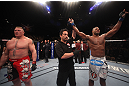 LAS VEGAS, NV - DECEMBER 30:  Alistair Overeem (right) is declared the winner in his fight over Brock Lesnar (left) during the UFC 141 event at the MGM Grand Garden Arena on December 30, 2011 in Las Vegas, Nevada.  (Photo by Donald Miralle/Zuffa LLC/Zuffa LLC via Getty Images) *** Local Caption *** Alistair Overeem; Brock Lesnar