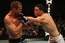 LAS VEGAS, NV - DECEMBER 30:  Nate Diaz (right) punches Donald Cerrone during the UFC 141 event at the MGM Grand Garden Arena on December 30, 2011 in Las Vegas, Nevada.  (Photo by Donald Miralle/Zuffa LLC/Zuffa LLC via Getty Images) *** Local Caption *** Nate Diaz; Donald Cerrone