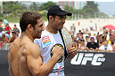 RIO DE JANEIRO, BRAZIL - JANUARY 11:  (R-L) UFC Featherweight Champion Jose Aldo and challenger Chad Mendes pose for photos during the UFC 142 Open Workouts at Barra de Tijuca Beach on January 11, 2012 in Rio de Janeiro, Brazil.  (Photo by Josh Hedges/Zuffa LLC/Zuffa LLC via Getty Images)