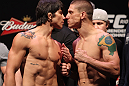 RIO DE JANEIRO, BRAZIL - JANUARY 13:  (L-R) Opponents Erick Silva and Carlo Prater face off after weighing in during the UFC 142 Weigh In at HSBC Arena on January 13, 2012 in Rio de Janeiro, Brazil.  (Photo by Josh Hedges/Zuffa LLC/Zuffa LLC via Getty Images)
