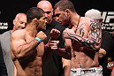 RIO DE JANEIRO, BRAZIL - JANUARY 13:  (L-R) Rousimar Palhares and Mike Massenzio face off after weighing in during the UFC 142 Weigh In at HSBC Arena on January 13, 2012 in Rio de Janeiro, Brazil.  (Photo by Josh Hedges/Zuffa LLC/Zuffa LLC via Getty Images)