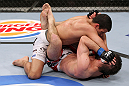 RIO DE JANEIRO, BRAZIL - JANUARY 14:  Felipe Arantes (Top) punches Antonio Carvalho (Bottom) in a featherweight bout during UFC 142 at HSBC Arena on January 14, 2012 in Rio de Janeiro, Brazil.  (Photo by Josh Hedges/Zuffa LLC/Zuffa LLC via Getty Images)