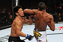 RIO DE JANEIRO, BRAZIL - JANUARY 14:  Yuri Alcantara (R) elbows Michihiro Omigawa (L) in a featherweight bout during UFC 142 at HSBC Arena on January 14, 2012 in Rio de Janeiro, Brazil.  (Photo by Josh Hedges/Zuffa LLC/Zuffa LLC via Getty Images)